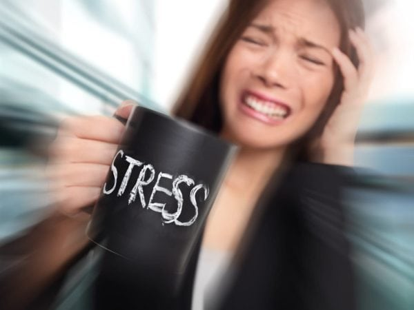 image of young woman needing stress management