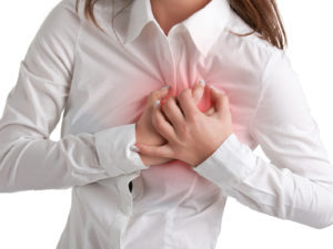 Workplace stress Woman having a pain in the heart